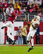 Alabama defensive back Trevon Diggs (7) tips a pass away from Tennessee wide receiver Josh Palmer (5) at Bryant-Denny Stadium in Tuscaloosa, Ala., on Saturday October 19, 2019.