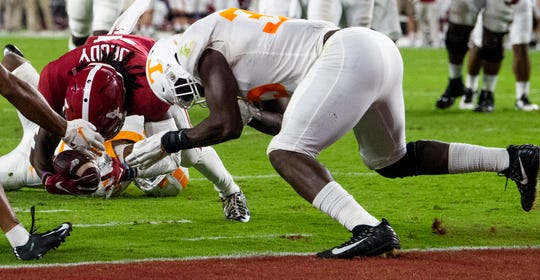 Tennessee linebacker Daniel Bituli (35) is called for targeting on this play against Alabama wide receiver Jerry Jeudy (4) at Bryant-Denny Stadium in Tuscaloosa, Ala., on Saturday October 19, 2019.