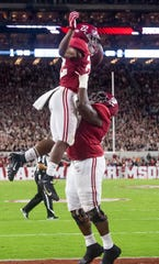 Alabama running back Najee Harris (22) is lifted by offensive lineman Deonte Brown (65) after scoring a touchdown against Tennessee at Bryant-Denny Stadium in Tuscaloosa, Ala., on Saturday October 19, 2019.