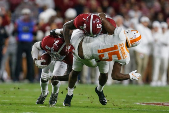 Oct 19, 2019; Tuscaloosa, AL, USA; Alabama Crimson Tide defensive back Jared Mayden (21) intercepts a pass after a hit on Tennessee Volunteers wide receiver Jauan Jennings (15) by Alabama Crimson Tide defensive back Xavier McKinney (15) during the first half of an NCAA football game at Bryant-Denny Stadium. Mandatory Credit: Butch Dill-USA TODAY Sports