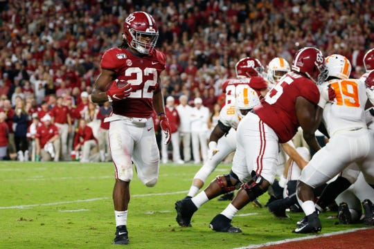 Oct 19, 2019; Tuscaloosa, AL, USA; Alabama Crimson Tide running back Najee Harris (22) carries the ball in for a touchdown during the first half of an NCAA football game against the Tennessee Volunteers at Bryant-Denny Stadium. Mandatory Credit: Butch Dill-USA TODAY Sports