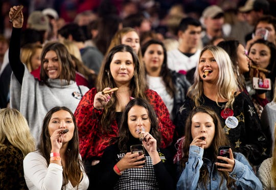 Alabama fans smoke victory cigars after Alabama defeated Tennessee at Bryant-Denny Stadium in Tuscaloosa, Ala., on Saturday October 19, 2019.