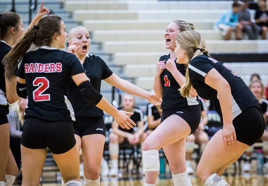 Wapahani players celebrate after scoring a point against Lapel in the sectional championship game at Lapel High School Saturday, Oct. 19, 2019.