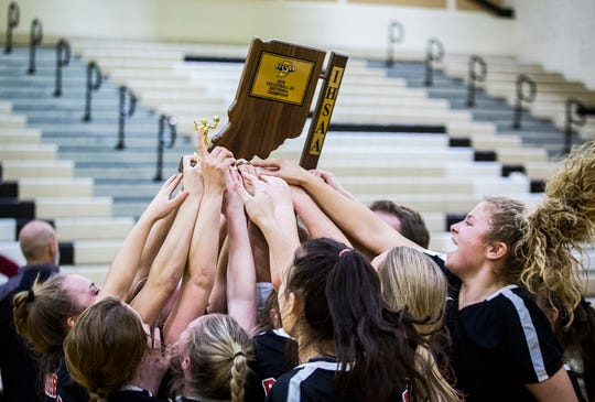 Wapahani players hoist the program's first sectional championship since 2016 after beating Lapel 3-0 at Lapel High School Saturday, Oct. 19, 2019.