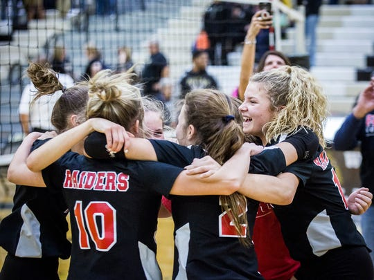 Wapahani players celebrate during its sectional championship game against Lapel at Lapel High School Saturday, Oct. 19, 2019. Wapahani won the match 3-0.
