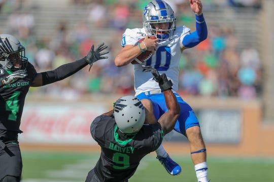 MTSU's Asher O'Hara (10) attempts to hurdle a North Texas defender on October 19, 2019.