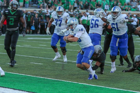 Chase Cunningham (16) dives forward the late game-tying touchdown against North Texas on October 19, 2019.