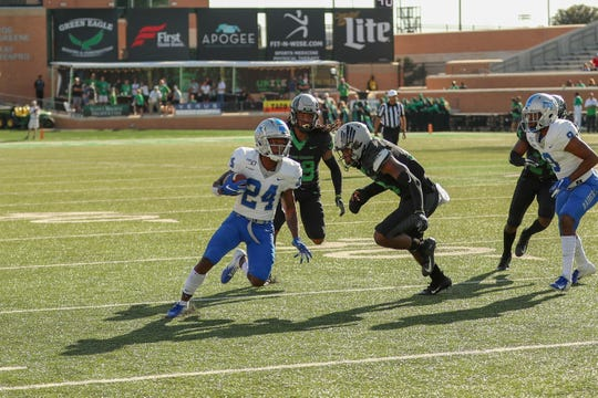 MTSU's Zack Dobson (24) turns down field past a North Texas player on October 19, 2019.