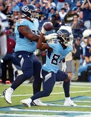 Titans wide receiver Corey Davis (84) celebrates his touchdown late in the second quarter Sunday to tie the score 10-10.