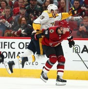 Arizona Coyotes defenseman Jason Demers (55) battles for the puck against Nashville Predators center Calle Jarnkrok (19) in the third period at Gila River Arena.