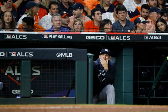 New York Yankees manager Aaron Boone watches during the fourth inning in Game 6 of baseball's American League Championship Series against the Houston Astros Saturday, Oct. 19, 2019, in Houston.