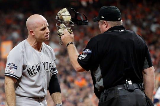 New York Yankees' Brett Gardner argues with home plate umpire Mark Carlson during the second inning in Game 6 of baseball's American League Championship Series against the Houston Astros Saturday, Oct. 19, 2019, in Houston.