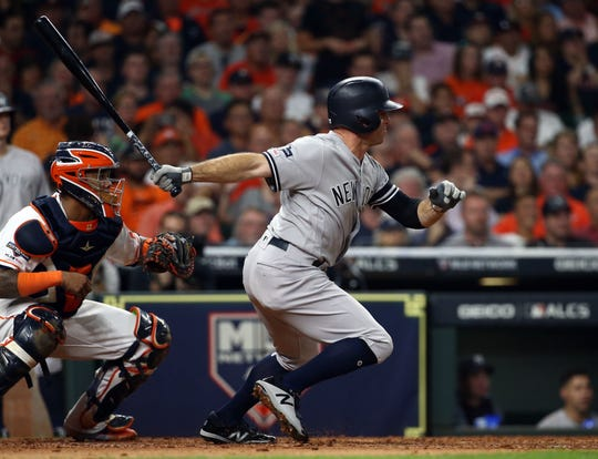 Oct 19, 2019; Houston, TX, USA; New York Yankees left fielder Brett Gardner (11) hits a single during the fourth inning against the Houston Astros in game six of the 2019 ALCS playoff baseball series at Minute Maid Park.