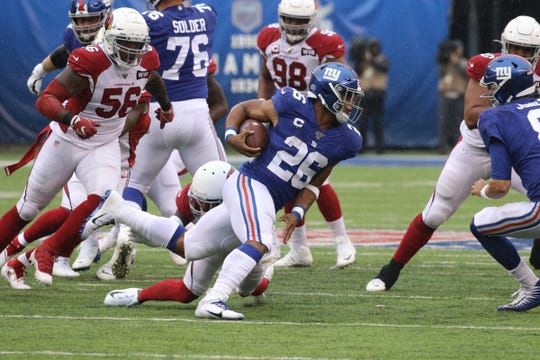 Saquon Barkley of the GiantsÊrunning the ball in the first half during the game between the Arizona Cardinals and the New York Giants at MetLife Stadium in east Rutherford on October 20, 2019.