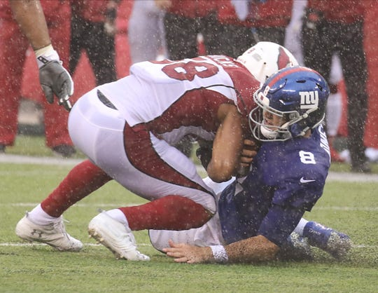 Jordan Hicks of the Cardinals was penalized on this play after he hit Giants quarterback, Daniel Jones during the game between the Arizona Cardinals and the New York Giants at MetLife Stadium in east Rutherford on October 20, 2019.