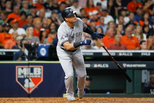 New York Yankees' Gio Urshela watches his home run against the Houston Astros during the fourth inning in Game 6 of baseball's American League Championship Series Saturday, Oct. 19, 2019, in Houston.