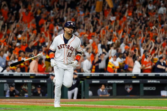 Houston Astros' Yuli Gurriel hits a three-run home run against the New York Yankees during the first inning in Game 6 of baseball's American League Championship Series Saturday, Oct. 19, 2019, in Houston.