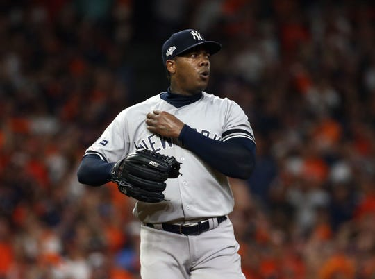 Oct 19, 2019; Houston, TX, USA; New York Yankees relief pitcher Aroldis Chapman (54) prepares to deliver a pitch during the ninth inning against the Houston Astros in game six of the 2019 ALCS playoff baseball series at Minute Maid Park.