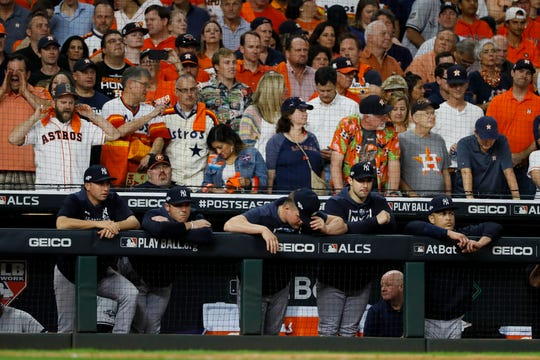 Members of the New York Yankees watch during the ninth inning in Game 6 of baseball's American League Championship Series against the Houston Astros Saturday, Oct. 19, 2019, in Houston.