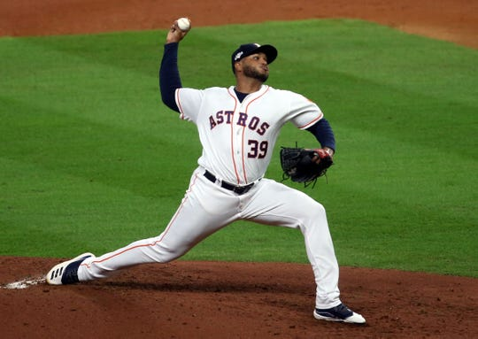 Oct 19, 2019; Houston, TX, USA; Houston Astros relief pitcher Josh James (39) delivers a pitch during the second inning against the New York Yankees in game six of the 2019 ALCS playoff baseball series at Minute Maid Park.