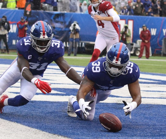 Michael Thomas and Eli Penny of the Giants chase a loose ball in the end zone, recovered by Penny as he scored a Giants TD in the second quarter from a blocked punt in the game between the Arizona Cardinals and the New York Giants at MetLife Stadium in east Rutherford on October 20, 2019.