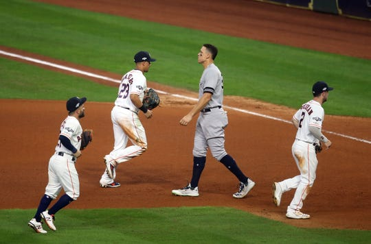 Oct 19, 2019; Houston, TX, USA; Houston Astros second baseman Jose Altuve (27) left fielder Michael Brantley (23) and third baseman Alex Bregman (2) run off the field after getting New York Yankees right fielder Aaron Judge (99) out in a double play during the seventh inning in game six of the 2019 ALCS playoff baseball series at Minute Maid Park.