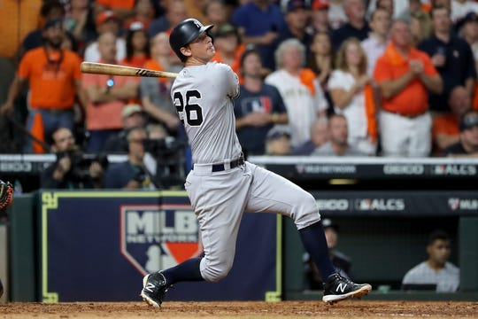 DJ LeMahieu #26 of the New York Yankees hits a game-tying two-run home run against the Houston Astros during the ninth inning in game six of the American League Championship Series at Minute Maid Park on October 19, 2019 in Houston, Texas.