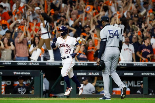 Houston Astros' Jose Altuve celebrate after a two-run home run off New York Yankees pitcher Aroldis Chapman to win Game 6 of baseball's American League Championship Series against the New York Yankees Saturday, Oct. 19, 2019, in Houston. The Astros won 6-4 to win the series 4-2.