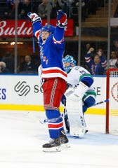 New York Rangers right wing Jesper Fast (17) reacts after scoring a goal against the Vancouver Canucks during the second period at Madison Square Garden.