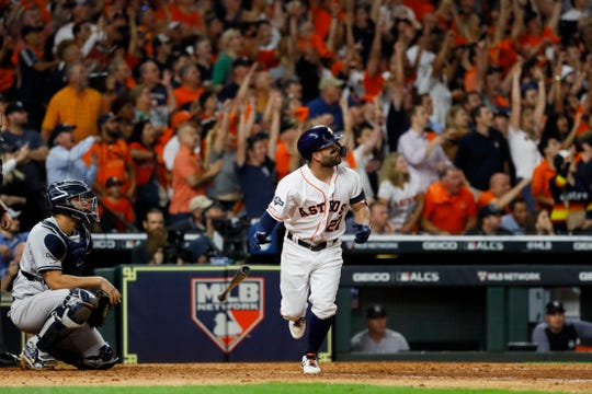 Houston Astros' Jose Altuve watches his two-run walk-off to win Game 6 of baseball's American League Championship Series against the New York Yankees Saturday, Oct. 19, 2019, in Houston. The Astros won 6-4 to win the series 4-2.
