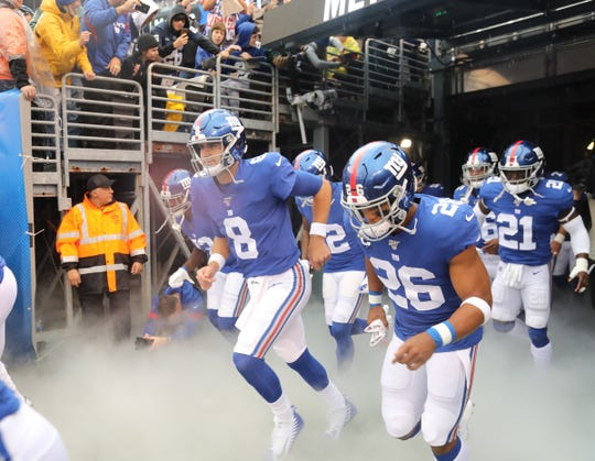 Daniel Jones and Saquon Barkley head put onto the field before the start of the game between the Arizona Cardinals and the New York Giants at MetLife Stadium in east Rutherford on October 20, 2019.