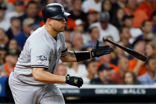 New York Yankees' Gary Sanchez watches his RBI-single against the Houston Astros during the second inning in Game 6 of baseball's American League Championship Series Saturday, Oct. 19, 2019, in Houston.