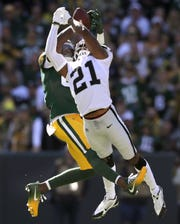 Green Bay Packers wide receiver Geronimo Allison (81) pulls in a first half pass under the defense of Oakland Raiders cornerback Gareon Conley (21) during their football game Sunday, October 20, 2019, at Lambeau Field in Green Bay, Wis.