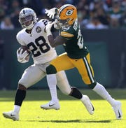 Packers cornerback Will Redmond tackles Raiders running back Josh Jacobs on Oct. 20.