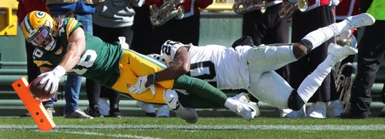 Green Bay Packers wide receiver Jake Kumerow (16) scores a touchdown on a 37-yard reception while being covered by Oakland Raiders cornerback Daryl Worley (20) during the second quarter of their game Sunday, October 20, 2019 at Lambeau Field in Green Bay, Wis.