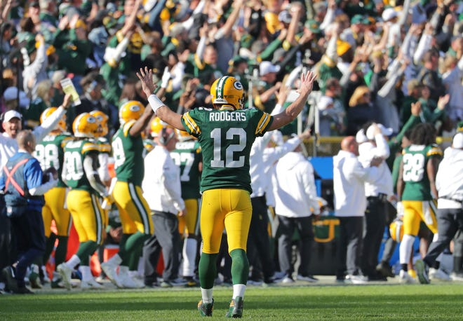 Green Bay Packers quarterback Aaron Rodgers (12) celebrates his 74 yard touchdown pass to Green Bay Packers wide receiver Marquez Valdes-Scantling (83) during the 4th quarter of the Green Bay Packers 42-24 win over the Oakland Raiders at Lambeau Field in Green Bay  on Sunday, Oct. 20, 2019.  Photo by Mike De Sisti/Milwaukee Journal Sentinel