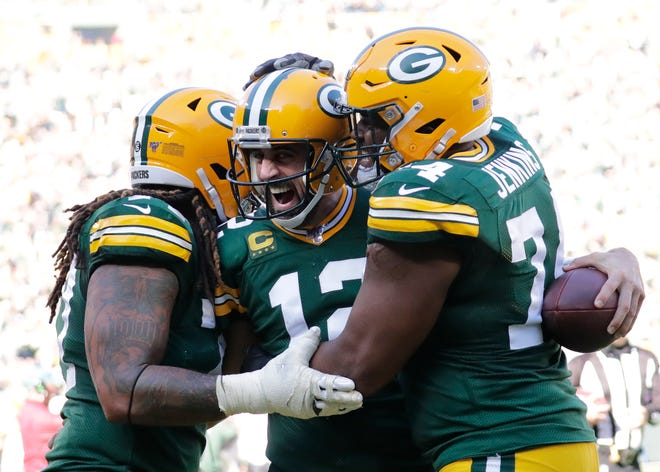 Green Bay Packers quarterback Aaron Rodgers (12) celebrates scoring a touchdown run with Billy Turner (77), and Elgton Jenkins (74) in the third quarter Sunday, October 20, 2019, at Lambeau Field in Green Bay, Wis. Dan Powers/USA TODAY NETWORK-Wisconsin