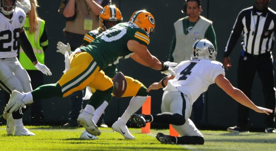 Oakland Raiders quarterback Derek Carr (4) fumbles the ball while trying to score a touchdown during the second quarter of their game Sunday, October 20, 2019 at Lambeau Field in Green Bay, Wis. The Packers recovered the ball. The Green Bay Packers beat the Oakland Raiders 42-24.  MARK HOFFMAN/MILWAUKEE JOURNAL SENTINEL