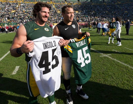 Packers fullback Danny Vitale, left, and Raiders fullback Alec Ingold exchange jerseys after their Oct. 20, 2019, game at Lambeau Field.