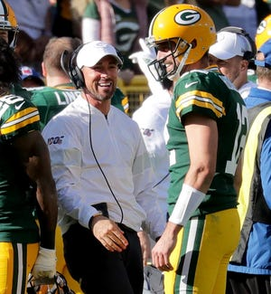 Packers quarterback Aaron Rodgers celebrates with coach Matt LaFleur during a 2019 rout of the Raiders.