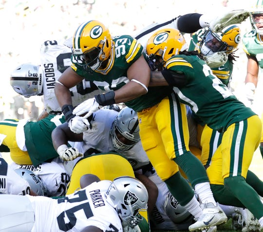 Green Bay Packers middle linebacker B.J. Goodson (93) stops Oakland Raiders running back Josh Jacobs (28) at tje goal line in the fourth quarter Sunday, October 20, 2019, at Lambeau Field in Green Bay, Wis. The Packers took over on downs.