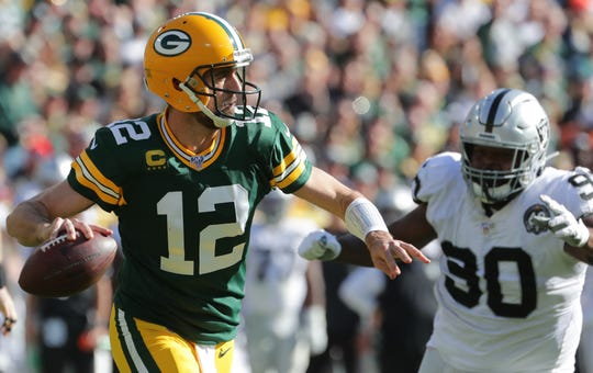 Green Bay Packers quarterback Aaron Rodgers (12) throws downfield during the third quarter of their game Sunday, October 20, 2019 at Lambeau Field in Green Bay, Wis. The Green Bay Packers beat the Oakland Raiders 42-24.  MARK HOFFMAN/MILWAUKEE JOURNAL SENTINEL