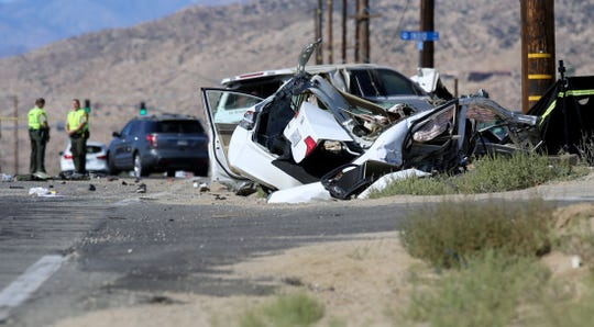Law enforcement block off Highway 62 near Indio Avenue in Yucca Valley, Calif., due to a two-vehicle collision on Saturday, October 19, 2019.