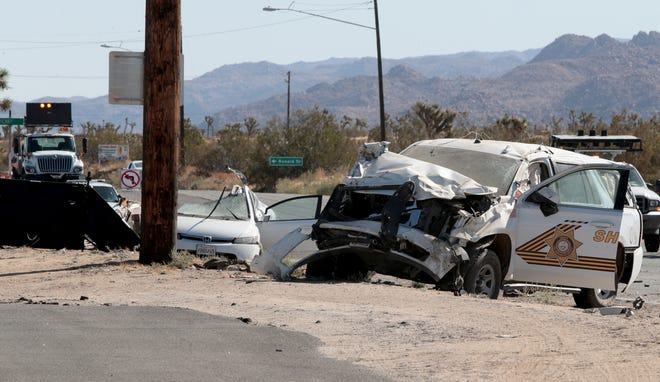 Law enforcement block off Highway 62 near Indio Avenue in Yucca Valley, Calif., Saturday morning as they investigate a two-vehicle collision involving a sheriff's deputy on Saturday, October 19, 2019.