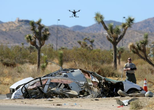 Law enforcement uses a drone to record the wreckage of a two-vehicle collision on Highway 62 near Indio Avenue in Yucca Valley, Calif., on Saturday, October 19, 2019.
