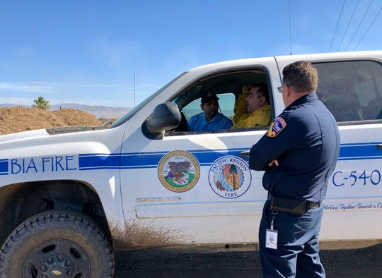 U.S. Rep. Raul Ruiz, D-Palm Desert, gets a briefing on the Martinez fire in Thermal that has been burning at a green waste recycling facility since Monday.