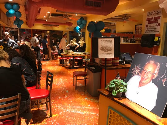 Friends and family gather at the public memorial for Bill Tracy, founder of Bill's Pizza, at the downtown Palm Springs restaurant on Oct. 19, 2019.
