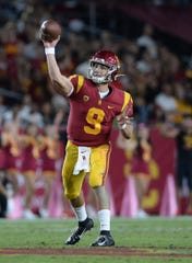 October 19, 2019; Los Angeles, CA, USA; Southern California Trojans quarterback Kedon Slovis (9) throws against the Arizona Wildcats during the first half at the Los Angeles Memorial Coliseum.