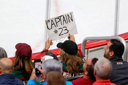A fan holds a sign for Arizona Coyotes defenseman Oliver Ekman-Larsson (23) against the Ottawa Senators on Oct. 19, 2019 in Glendale, Ariz.