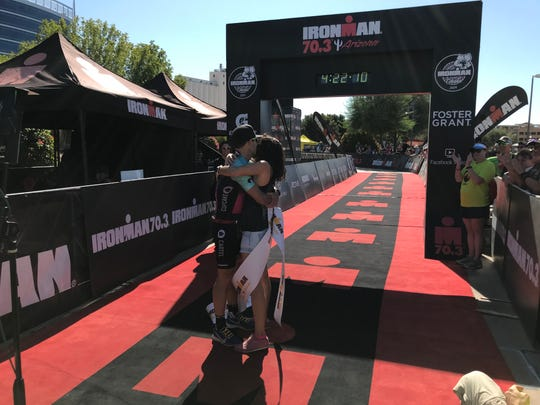 Manuel Diaz of Phoenix celebrates with his wife Maria after winning the Iroman 70.3 Arizona triathlon Sunday in Tempe